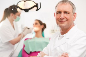 Dentist in dental office
